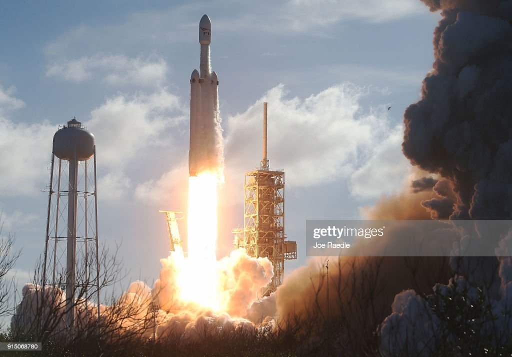 The SpaceX Falcon Heavy rocket lifts off from launch pad 39A at Kennedy Space Center on February 6, 2018 in Cape Canaveral, Florida. The rocket is the most powerful rocket in the world and is carrying a Tesla Roadster into orbit.