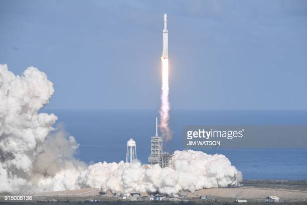 TOPSHOT The SpaceX Falcon Heavy takes off from Pad 39A at the Kennedy Space Center in Florida on February 6 on its demonstration mission The world's...