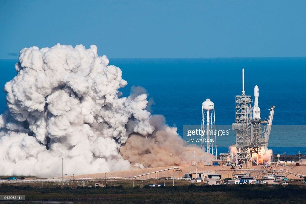 The SpaceX Falcon Heavy takes off from Pad 39A at the Kennedy Space Center in Florida, on February 6, 2018, on its demonstration mission. The world's most powerful rocket, SpaceX's Falcon Heavy, blasted off Tuesday on its highly anticipated maiden test flight, carrying CEO Elon Musk's cherry red Tesla roadster to an orbit near Mars. Screams and cheers erupted at Cape Canaveral, Florida as the massive rocket fired its 27 engines and rumbled into the blue sky over the same NASA launchpad that served as a base for the US missions to Moon four decades ago. WATSON
