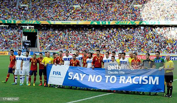 The Spain and Italy players display an antiracism message to the crowd prior to the FIFA Confederations Cup Brazil 2013 Semi Final match between...