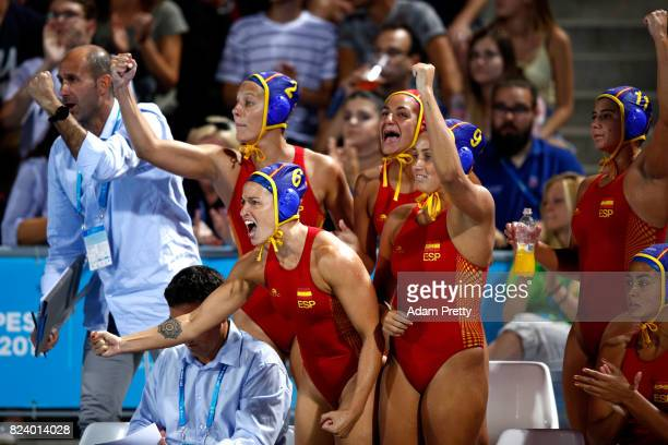 The Spain bench cheer on their teammates during the Women's Water Polo gold medal match between the Ubited States and Spain on day fifteen of the...