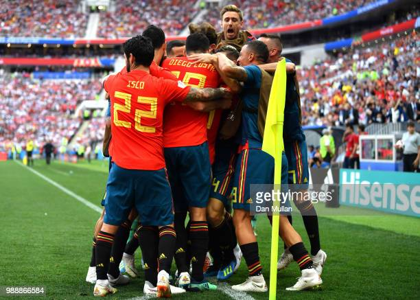 The Spain team celebrate after Sergey Ignashevich of Russia scores an own goal for Spain's first goal during the 2018 FIFA World Cup Russia Round of...