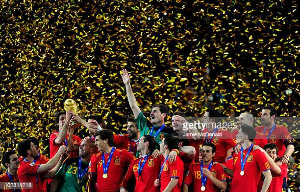 The Spain team celebrate winning the World Cup as captain Iker Casillas waves to fans during the 2010 FIFA World Cup South Africa Final match between...