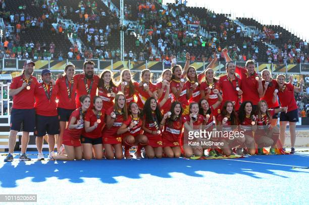 The Spain team celebrate with their Bronze Medals during the presentation following the FIH Womens Hockey World Cup Final between Netherlands and...