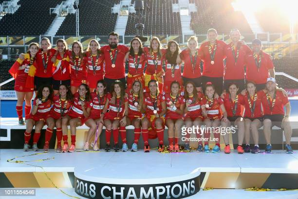 The Spain team pose for a group photo on the winners stage after they win the Bronze Medal during the Final game between Netherlands and Ireland of...