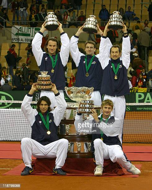 The Spainish Davis Cup team holds their trophies From left to right are Juan Carlos Ferrero Tommy Robredo Jordi Arrese Rafael Nadal and Carlos Moya...