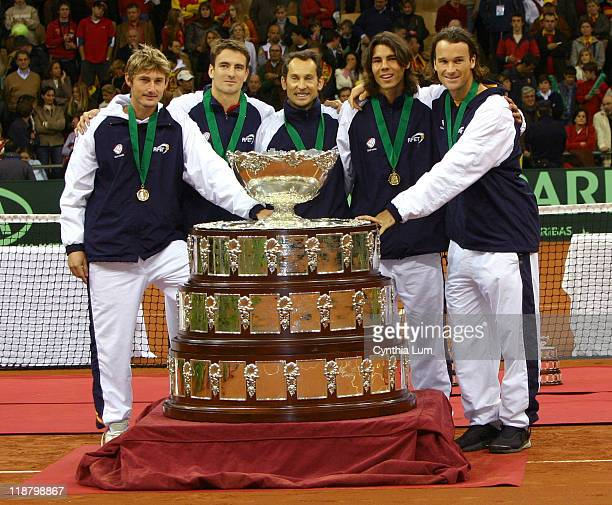 The Spainish Davis Cup team stands with the team trophy From left to right are Juan Carlos Ferrero Tommy Robredo Jordi Arrese Rafael Nadal and Carlos...