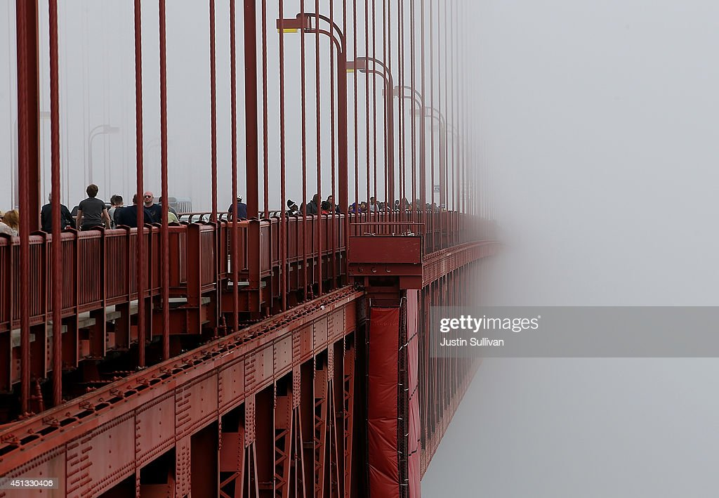 The span of the Golden Gate Bridge disappears into the fog on June 27, 2014 in San Francisco, California. The Golden Gate Bridge district's board of directors voted unanimously to approve a $76 million funding package to build a net suicide barrier on the iconic span. Over 1,500 people committed suicide by jumping from the iconic bridge since it opened in 1937. 46 people jumped to their death in 2013.