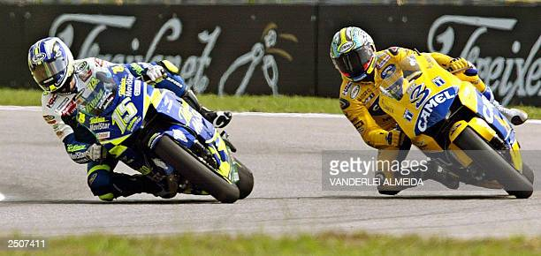 The Spaniard of the Movistar/Honda MotoGP team Sete Gibernau and the Italian Max Biaggi of Camel Pons team take a turn during a free practice session...