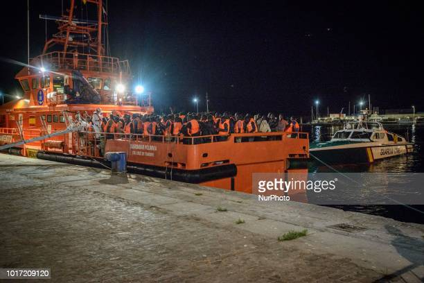 Migrants waiting at the Malaga harbour to be transferred to a center in Malaga Spain on August 14 2018