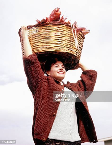 The Spanish actress Carmen Sevilla with a seafood basket at his home in San Juan Alicante Spain