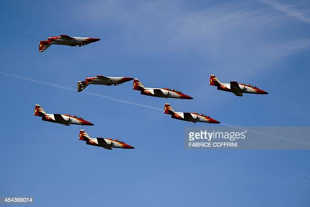 The Spanish Air Force's Patrulla Aguila aerobatic team performs on the first day of the AIR14 air show in Payerne western Switzerland on August 30...