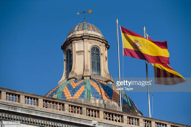 The Spanish and Catalan flags fly above the Catalan Government building the Palau de la Generalitat on October 28 2017 in Barcelona Spain The Spanish...
