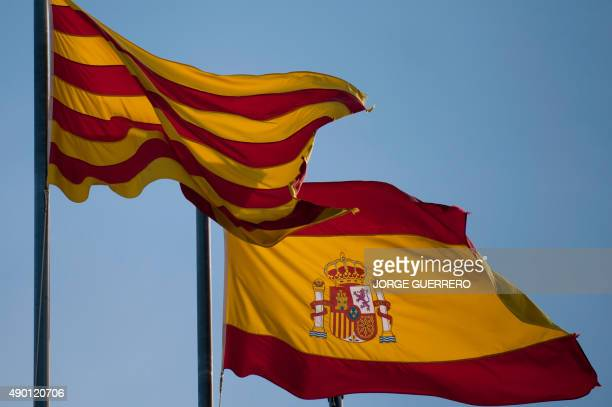 The Spanish and 'Senyera' Catalan flags fly near to the Palau de la Generalitat the Catalan regional government headquarters in Barcelona on...