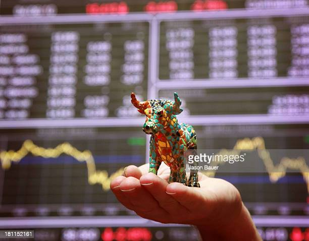 The Spanish bull the national symbol of Spain in front of a display panel of the Madrid stock exchange in the trading room