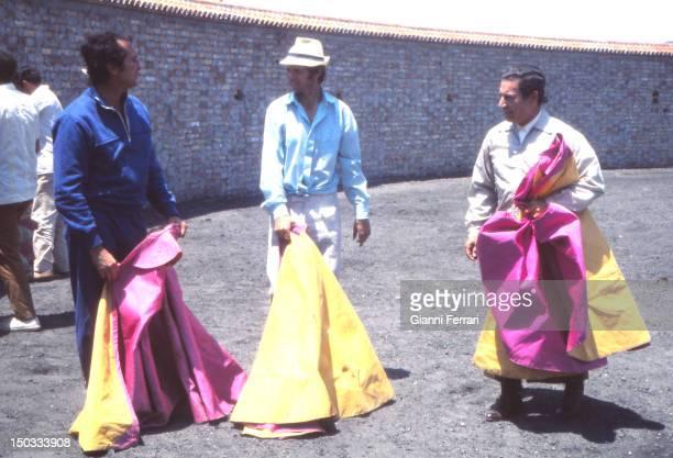 The Spanish bullfighter Manuel Benitez 'El Cordobes' on his farm of Villalobillos with two great bullfighters Luis Miguel Dominguin and Antonio...