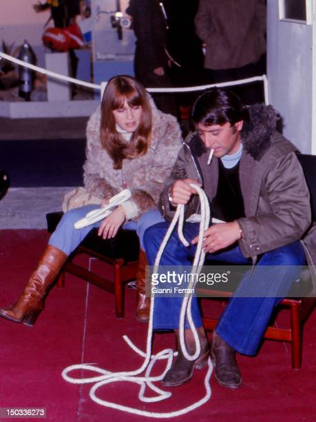 The Spanish dancer Antonio Gades with his wife the Spanish singer and actress Marisol learning to tie knots sailors in a boat show Valencia Spain