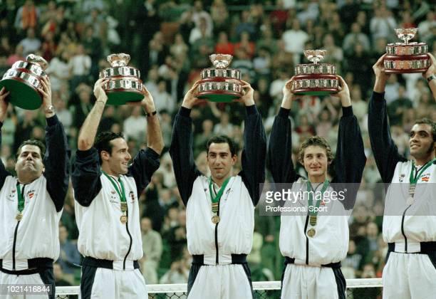 The Spanish Davis Cup team Javier Duarte , Alex Corretja, Albert Costa, Juan Carlos Ferrero and Joan Balcells lift their trophies after defeating...