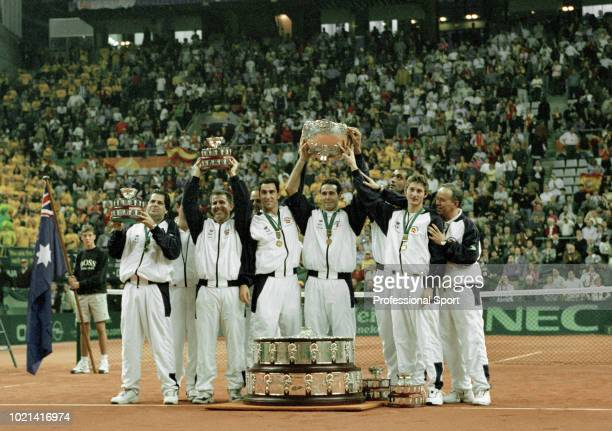 The Spanish Davis Cup team lift the trophy after defeating Australia in the Final of the Davis Cup between Spain and Australia at the Palau Sant...