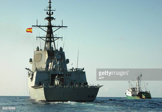 The Spanish fishing boat 'Playa de Bakio' is escorted by the Spanish frigate Mndez Nez after being freed by pirates in waters of Somalia on April 27...