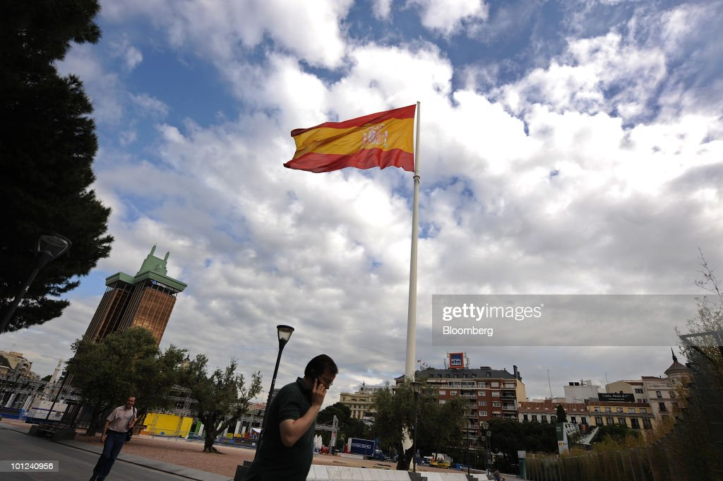 The Spanish flag flies at Plaza Colon in Madrid, Spain, on Friday, May 28, 2010. The restructuring of the Spanish savings bank industry can be completed by the end of June, Elena Salgado, Spain's economy minister, said today in Madrid. Photographer: Denis Doyle/Bloomberg via Getty Images