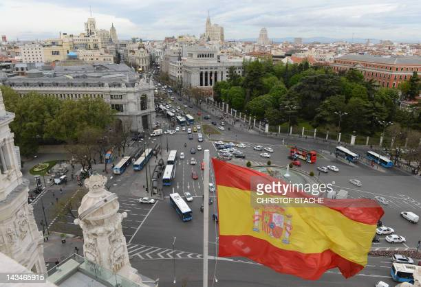 The Spanish flag flys at the Plaza de Cibeles in the Spanish capital Madrid on April 25 2012 Standard Poor's one of the top three credit rating...