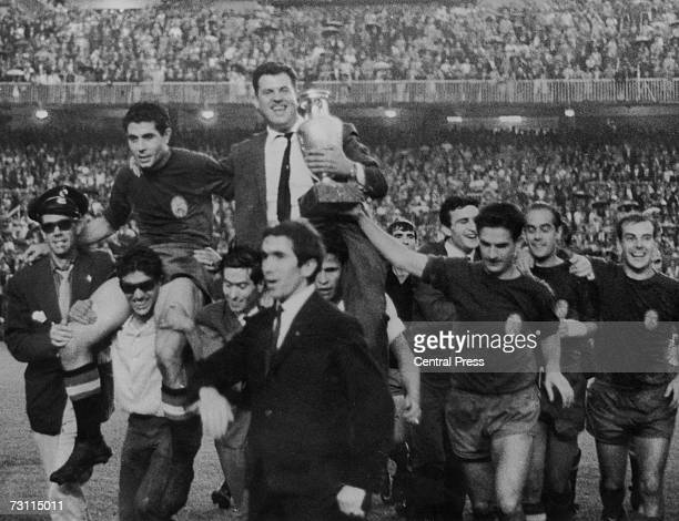 The Spanish football team bear their manager Jose Villalonga aloft to celebrate their victory in the European Nations Cup when they beat the Soviet...