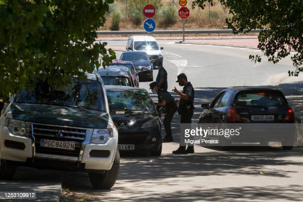 The Spanish Guardia Civil checks visitors at a checkpoint as they enter the San Juan swamp area on June 28 2020 in San Martin de Valdeiglesias Spain...
