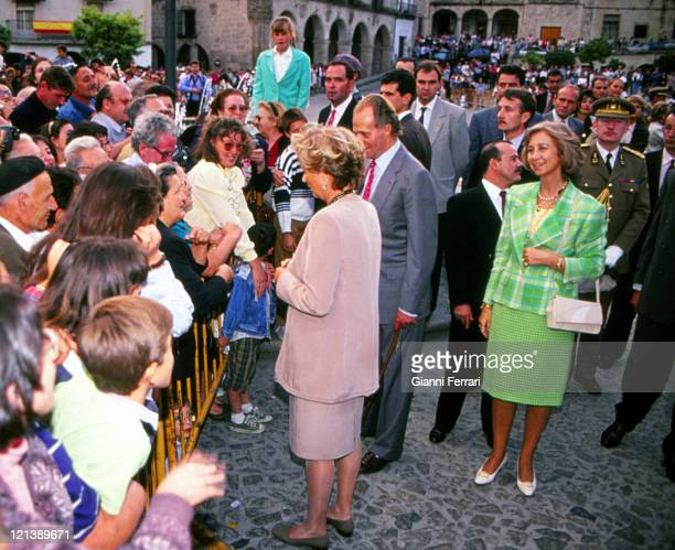 The Spanish King Juan Carlos and Sofia and Belgian Queen Paola greeting a group of people in Caceres Caceres Spain