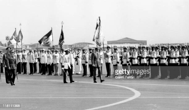 The Spanish King Juan Carlos and the Shah of Iran Reza Pahlavi honors the flag of Iran at the airport Teheran Iran