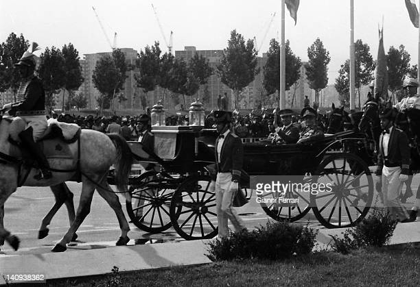 The Spanish King Juan Carlos and the Shah Reza Pahlavi hail from the horse carriage through the streets of Tehran Teheran Iran