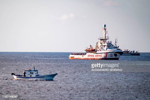 The Spanish migrant rescue NGO ship Open Arms is seen off the coast of the Italian island of Lampedusa on August 17, 2019. - Twenty-seven...