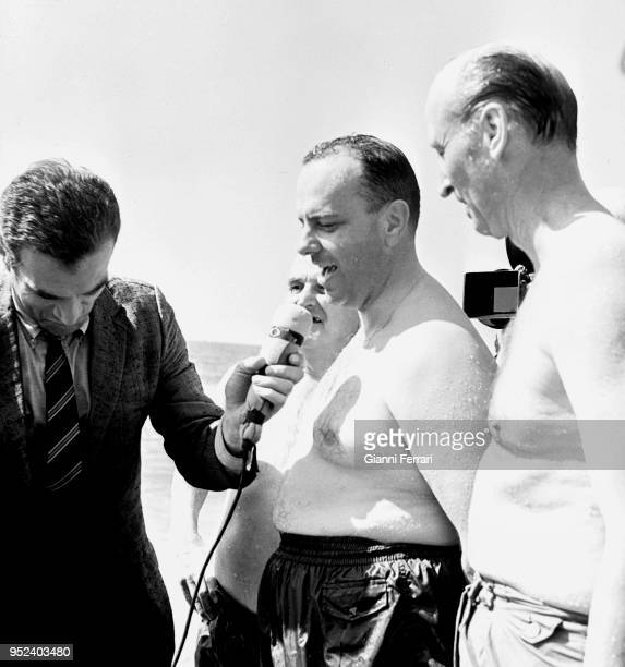 The Spanish Minister Manuel Fraga Iribarne together with the United States Ambassador on the beach of Quitapellejos after the fall of a hydrogen bomb...