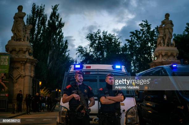 The Spanish Mossos D' Esquadra stand guard at the entrance to the Parliament of Catalonia on October 10 2017 in Barcelona Spain Many people are...