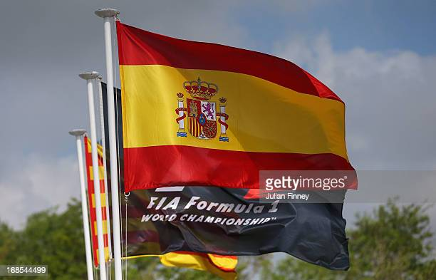 The Spanish national flag flies beside the FIA flag during qualifying for the Spanish Formula One Grand Prix at the Circuit de Catalunya on May 11...