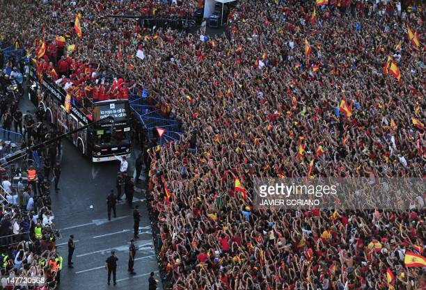 The Spanish national football team arrives on Cibeles Square on July 2 2012 after parading through Madrid a day after it won the final match of the...