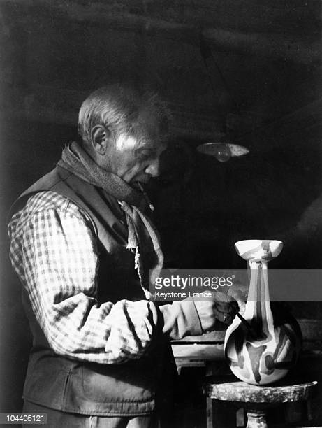 The Spanish painter and sculture maker Pablo PICASSO is decorating a piece of pottery in his Vallauris studio