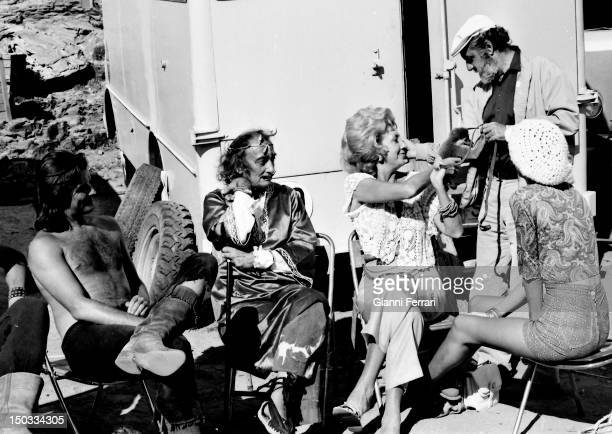 The Spanish painter Salvador Dali visiting the actors shooting the film 'Light of the Edge of the World ' 13th October 1970 Cadaques Spain