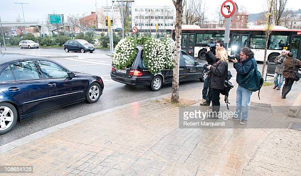 The Spanish press pursues the hearse and family car of Carlota Canto Cobo on the way to her funeral on January 31, 2011 in Barcelona, Spain.