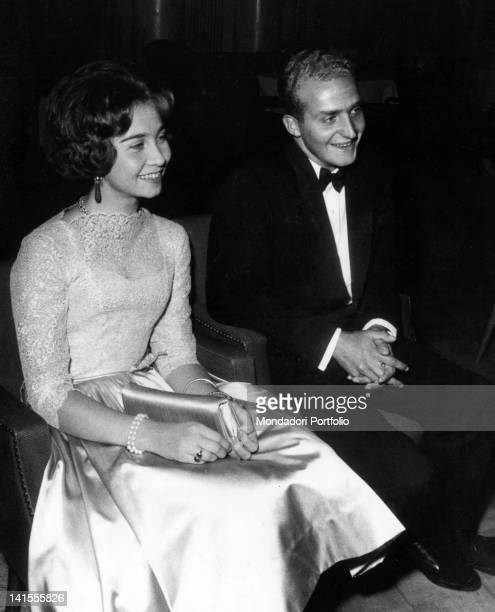 The Spanish prince Juan Carlos of Borboun wearing a tuxedo as he is sitting next to fiancee Sophia of Greece 1961