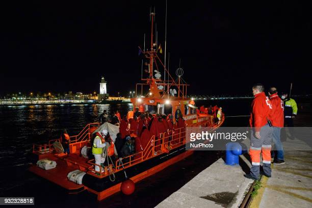 The Spanish Red Cross attending 48 migrants at the Harbour of Malaga on 14 March 2018 in Malaga Spain Late in the afternoon 48 migrants among them 4...