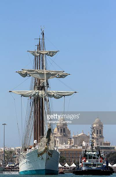 The Spanish school Goleta Juan Sebastian de Elcano Class A of 1927 the bottom of the picture you can see the Cathedral of Cadiz takes part in the...