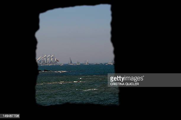 The Spanish schooner Juan Sebastian de Elcano is seen through a wall during the 2012 Gran Regata Cadiz Tall Ships' Races in Cadiz on July 29 2012 AFP...