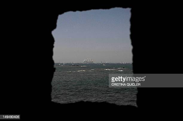 The Spanish schooner Juan Sebastian de Elcano is seen through an opening in a wall during the 2012 Gran Regata Cadiz Tall Ships' Races in Cadiz on...