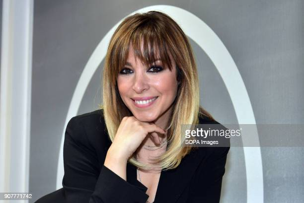 The Spanish singer Gisela visit the stand of the famous hairdresser and stylist Alberto Cerdán in the Cosmobeauty fair held in Barcelona