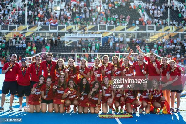 The Spanish team pose and celebrate with their bronze medals during a presentation following the final field hockey match between the Netherlands and...