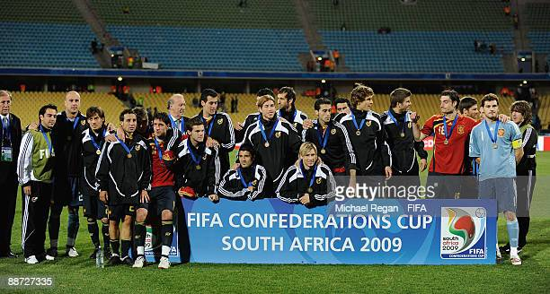 The Spanish team pose for photographers after winning the FIFA Confederations Cup 3rd Place Playoff between Spain and South Africa at the Royal...