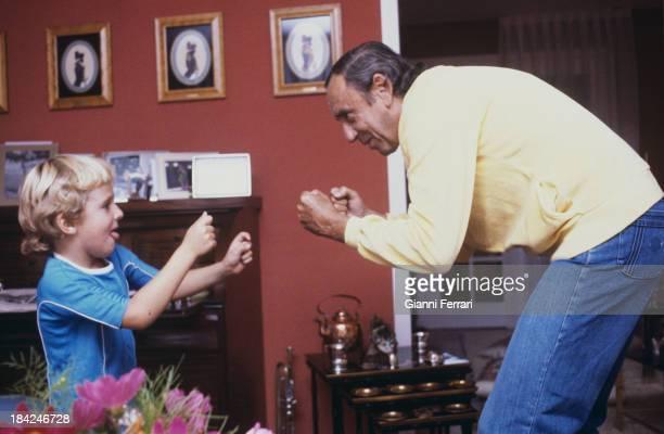 The Spanish TV presenter Joaquin Prat playing with his child Federico Madrid Castilla La Mancha Spain