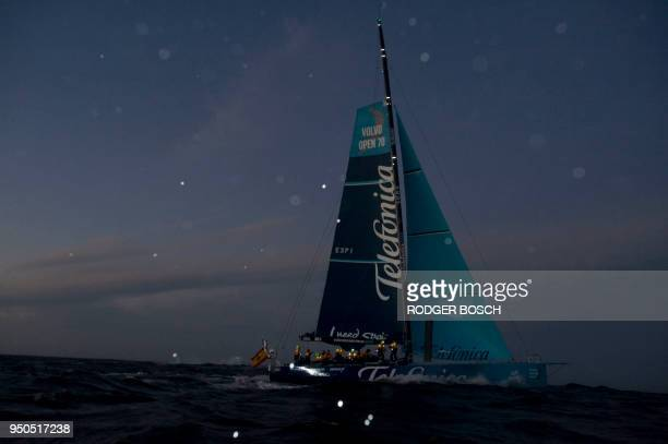 The Spanish yacht Telefonica sails into Table Bay, after sunset, to win the first leg of The 2011/2012 Volvo Ocean Race on November 26 off Cape Town,...