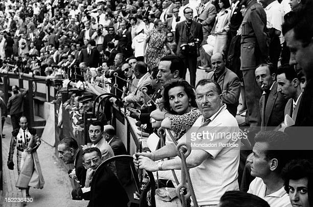 The SpanishAmerican musician and bandleader Xavier Cugat and his wife the American dancer and actress Abbe Lane watching a bullfight Madrid 1963